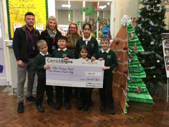 Carrick Signs presenting cheque to Elton Primary School